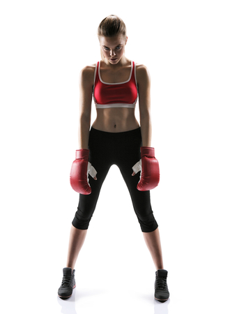 woman boxing gloves: Ready to attack girl wearing sport clothes and boxing gloves  photo set of sporty muscular female brunette girl wearing sports clothes over white background