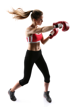 woman boxing gloves: Boxing woman punching wearing boxing gloves  photo set of sporty muscular female brunette girl wearing sports clothes over white background