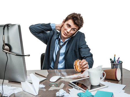 twiddle: Businessman scratches his head at working place sloth and laziness concept Stock Photo