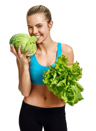 veggies: Young woman eating cabbage and holding lettuce in her hand organic food health and beauty care concept  photo set of cheerful brunette girl with healthy dietary eco organic food over white background Stock Photo