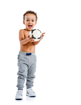 sports race: Mixed race boy holding soccer ball  photo set of Hispanic kid wearing sports clothes over white background