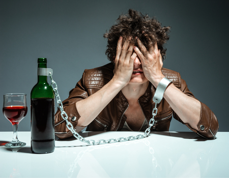 alcoholic man: Alcoholic in despair  photo of youth addicted to alcohol, alcoholism concept, social problem Stock Photo