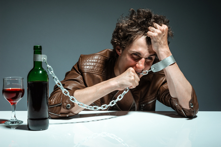 inebriated: Portrait of a drunk and depressed man  photo of youth addicted to alcohol, alcoholism concept, social problem Stock Photo