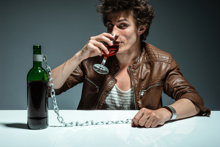 gyve: The drinking man  photo of youth addicted to alcohol, alcoholism concept, social problem