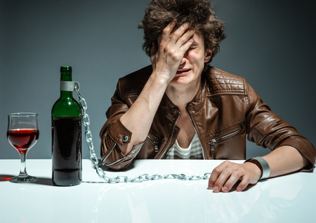 gyve: Lonely executive tensed due to job loss  photo of youth addicted to alcohol, alcoholism concept, social problem