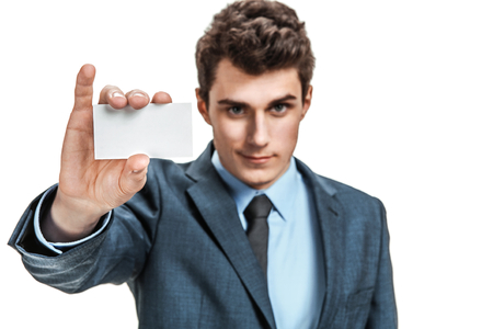 reach out: Businessman reach out on camera and show credit card or visiting card  photos of young businessman wearing  a suit and tie over white background