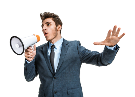 speaking trumpet: Dissatisfied manager screaming into a megaphone  photos of young businessman wearing  a suit and tie over white background