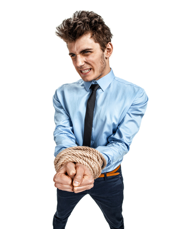 slovenly: Businessmans hands tied together with rope, modern slavery concept  photos of young man wearing shirt and tie over white background