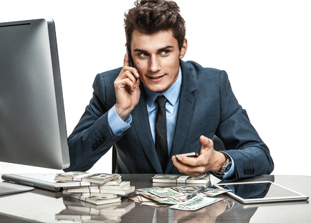 achiever: Young man talking by cell phone  modern businessman at the workplace Stock Photo