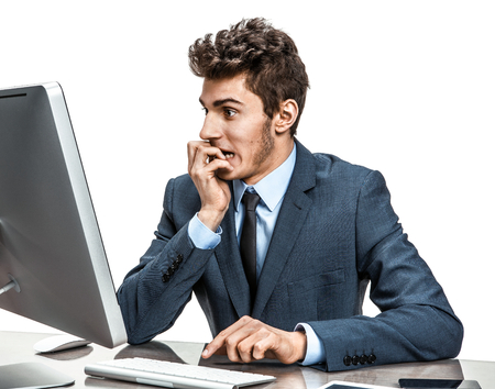 Employer looking at computer screen with horror  modern businessman at the workplace working with computer, depression and crisis concept