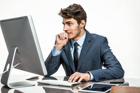 deadlock: Entrepreneur looking at computer screen with horror  modern businessman at the workplace working with computer, depression and crisis concept