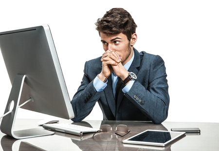 unfortunate: Unfortunate entrepreneur dissatisfied with his profit, income, earnings, gain, benefit, margin  modern businessman at the workplace working with computer, depression and crisis concept