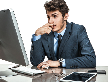 distressed: Dull entrepreneur dissatisfied with his profit, income, earnings, gain, benefit, margin  modern businessman at the workplace working with computer, depression and crisis concept Stock Photo