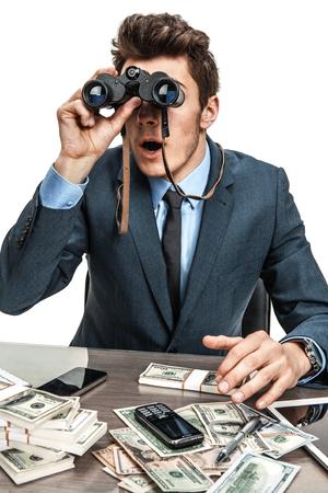 slacker: Businessman with binoculars  photos of modern businessman at the workplace