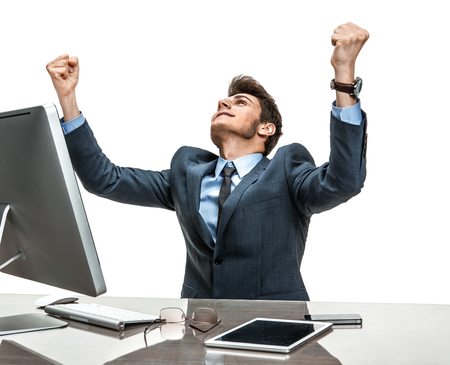 businessman working at his computer: Entrepreneur is satisfied with his profit, income, earnings, gain, benefit, margin  modern businessman at the workplace working with computer Stock Photo