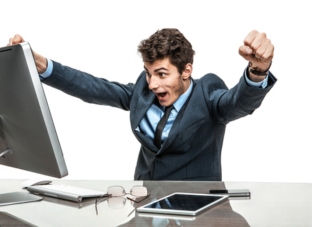 yeah: Cheerful is employer satisfied with his profit, income, earnings, gain, benefit, margin  modern businessman at the workplace working with computer