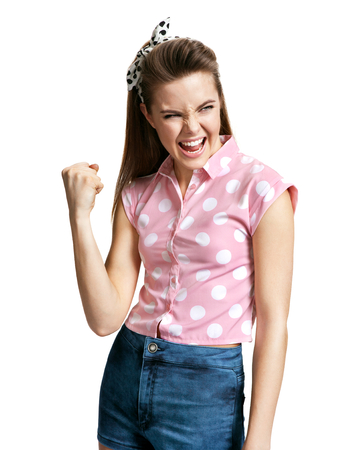 Victorious girl. Yeah! photo of young cheerful brunette woman over white background, positive emotions Archivio Fotografico