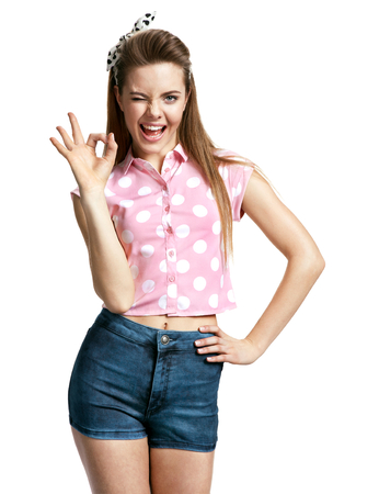 Happy smiling young woman showing okay gesture photo of young cheerful brunette woman over white background, positive emotions Reklamní fotografie
