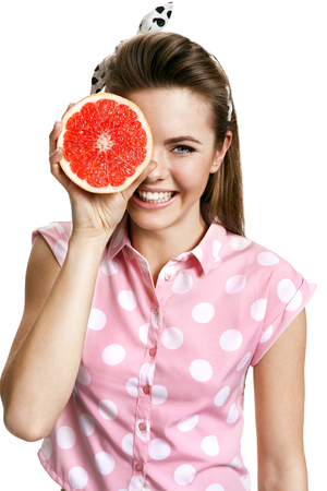 beauty woman: Young smiling woman with fresh juicy half of grapefruit, health and beauty care concept  Stock Photo