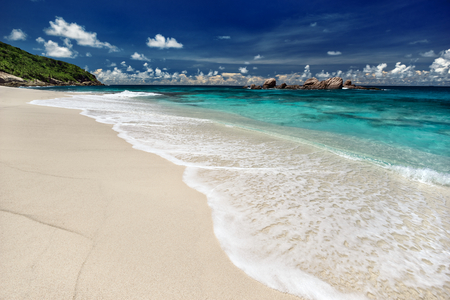 sandy beach: Soft wave of the sea on the sandy beach at summer sunny day outdoors photography of picturesque Seychelle islands