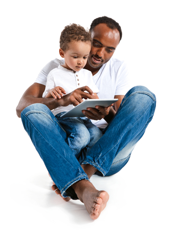 early education: Father and son using tablet computer. Learning and early education concept Stock Photo