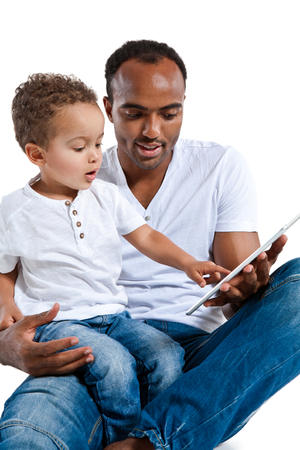 touchpad: Father helping son to use touchpad PC