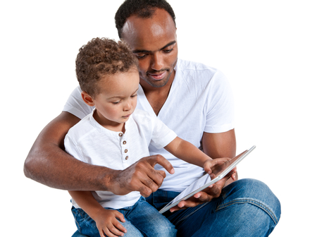 early education: Father and son reading fairy tale on touch pad computer. Learning and early education concept
