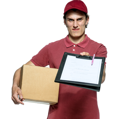 requires: Surly courier in red uniform with a box and tablet requires subscribe isolated on white background. Stock Photo