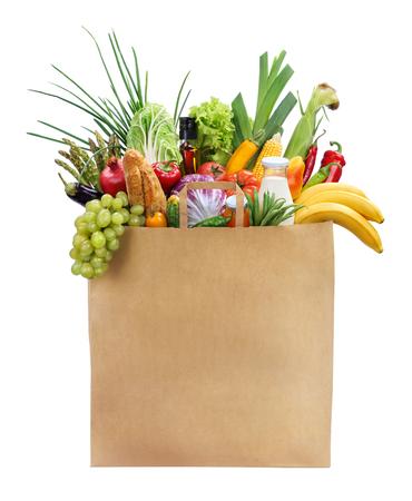 果物、野菜、パン、白い背景で隔離のボトル入りの飲料で茶色の買い物袋の最高の女性のための食品スタジオ撮影 写真素材
