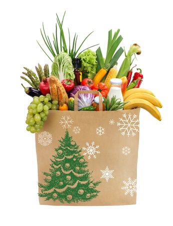 basket: Christmas shopping bag studio photography of brown grocery bag with fruits, vegetables, bread, bottled beverages - isolated over white background