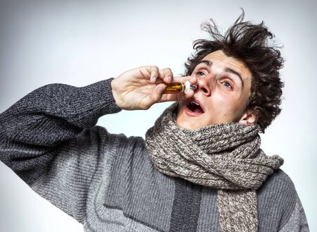 nose drops: Man Using Nose Spray Medication or drugs abuse, healthcare concept