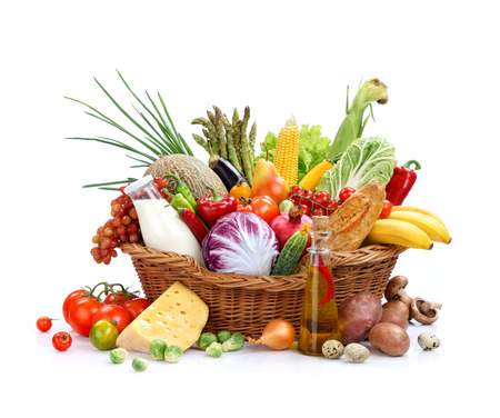 detoxing: Big full basket of healthy food studio photography of wicker basket with goods on isolated white background