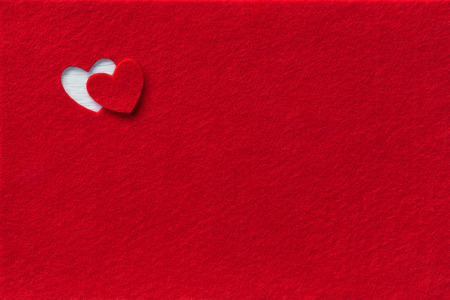 Felt Background for design to Valentine's Day. Decorative heart from red felt 스톡 콘텐츠