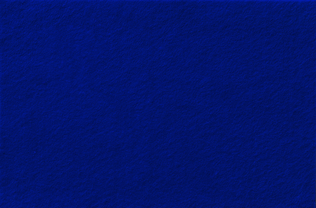 ultramarine: Dark blue Felt Background for design. View from above. Close up.