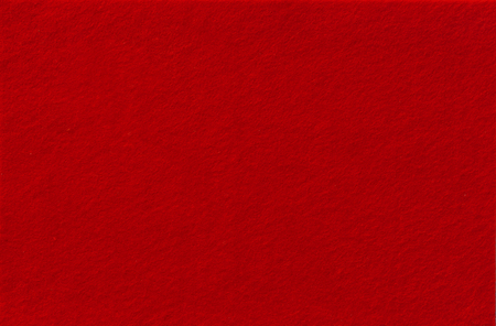 Dark red Felt Background for design. View from above. Close up.
