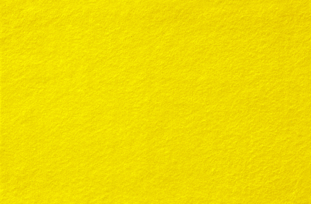 Yellow Felt Background for design. View from above. Close up.