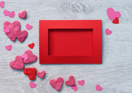 st valentin: Valentine red card with valentines heart shaped  on a white wooden background. Stock Photo