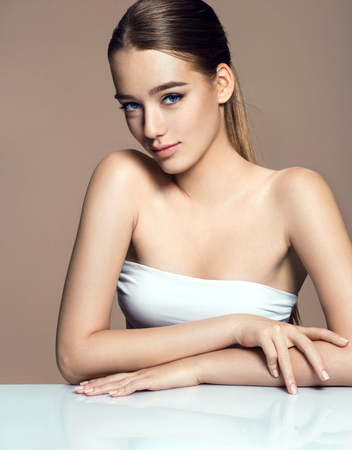 Young pretty woman with professional make-up on beige background 版權商用圖片