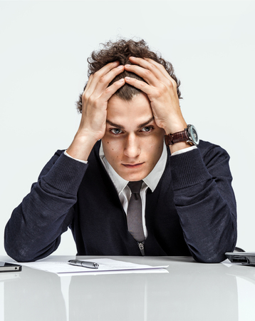 quandary: Oh my god, stressed businessman is taken for the head