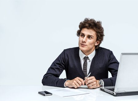 countenance: modern office man at working place on grey background. Depression and crisis concept Stock Photo