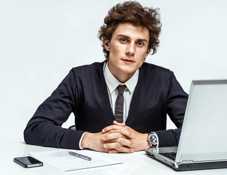ambitious: Ambitious young businessman looking at camera with serious look