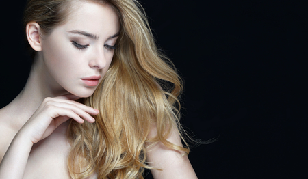 Woman with beauty face, skin care concept. Close-up of an attractive girl of European appearance on dark background. Stock Photo - 52582633