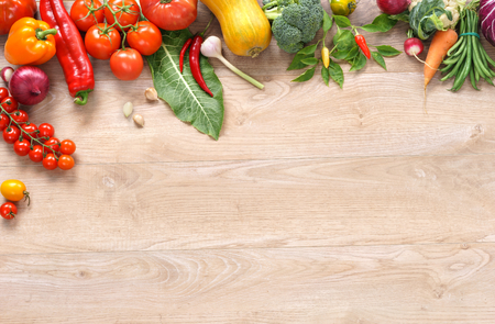 Ecological vegetables background high resolution product, studio photo of different vegetables on wooden table. Copy space.
