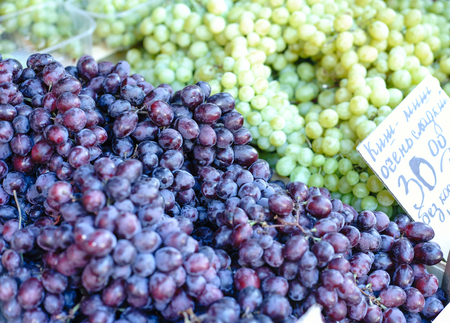 beauteous: Grape in a rustic wooden basket photography of grapes, grapes on market stall, close-up. Selective focus.