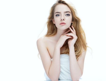 putting up: Beautiful girl with beautiful makeup, youth and skin care concept, photo of attractive blonde girl on white background Stock Photo