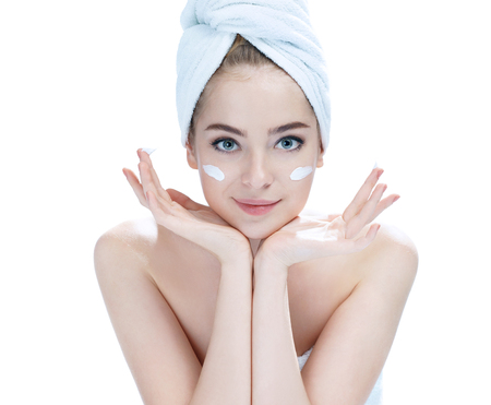 bath girl: Beautiful young lady applying moisturizing creme, skin care concept photos of attractive girl on white background Stock Photo