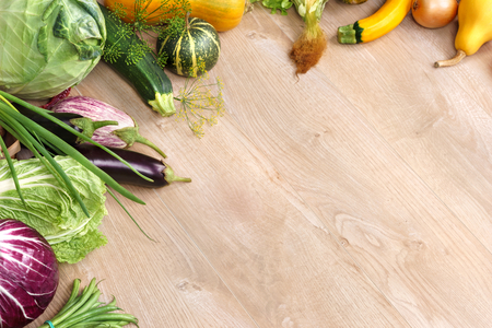 wooden table: Organic foods background. Space for your text, high-res product, studio photography of different vegetables on old wooden table.