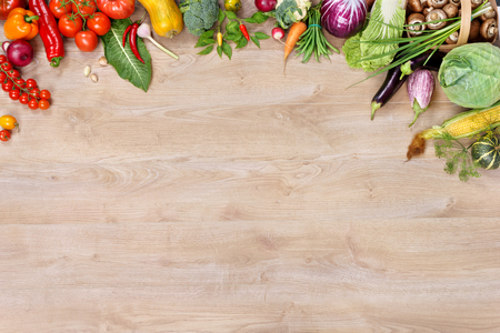 Ecological vegetables background. high resolution product, studio photo of different vegetables on wooden table. Copy space. Stock Photo