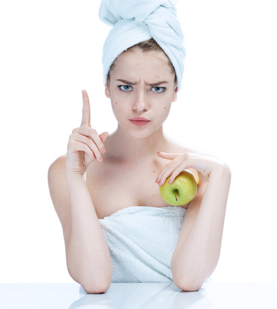 girl  care: Girl with a pimply face holding apple. Woman skin care concept photos of european girl on white background Stock Photo
