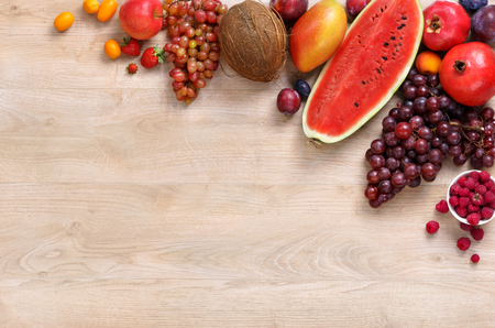 eating fruits: Healthy eating background, only fruits, studio photography of different fruits on wooden table. High resolution product.